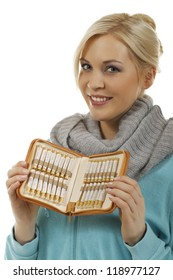 smiling woman shows homeopathic medicine