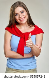 Smiling woman shows thumb up. Isolated female portrait.
