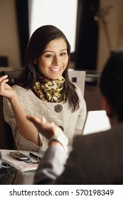 smiling woman sitting with man and discussing
