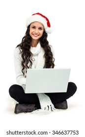 Smiling woman sitting on floor using laptop on white screen