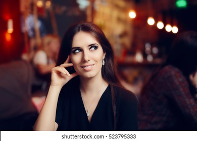 Smiling Woman at a Social Party in a Pub - Portrait of a beautiful elegant girl having fun at a celebration event