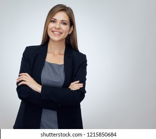Smiling woman standing with crossed arms. Businesswoman isolated professional portrait.