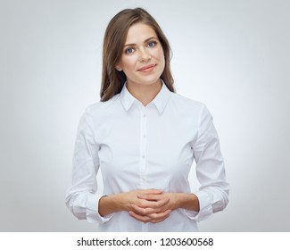 Smiling woman standing with folded hands. Isolated portrait on white.