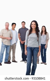Smiling woman standing with friends behind her against a white background