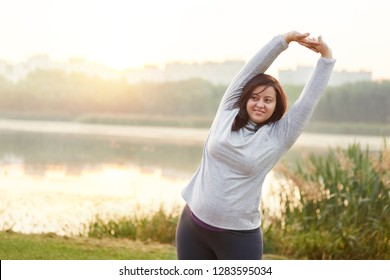 Smiling woman stretching her arms