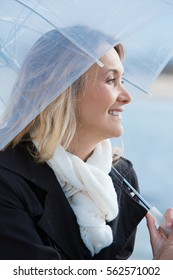 Smiling woman with an umbrella