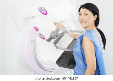 Smiling Woman Undergoing Mammogram X-ray Test