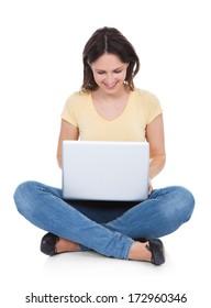 Smiling Woman Using Laptop Sitting On White Background