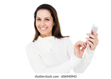 Smiling woman using smartphone on white background