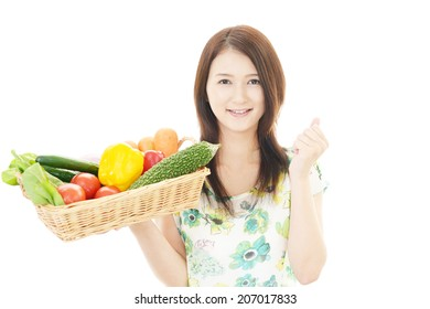 Smiling woman with vegetables