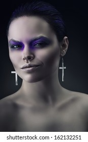 smiling woman with violet make-up