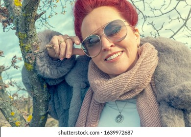 Smiling woman in warm clothes.