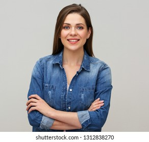 Smiling woman wearing blue denim shirt studio isolated portrait.
