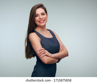 Smiling woman wearing business dress standing with crossed arms. isolated famale portrait.