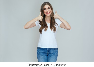 Smiling woman wearing casual white t shirt doing thumb up. isolated studio portrait.