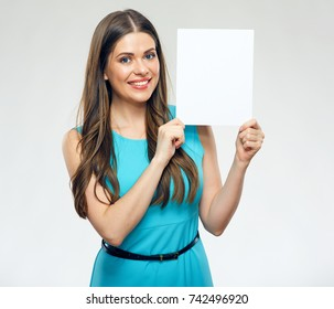 Smiling woman wearing dress holding advertising board. Isolated portrait.
