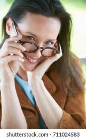Smiling woman wearing eyeglasses