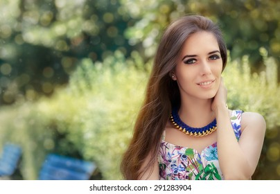 Smiling Woman Wearing Floral Dress and Big Necklace - Fashion girl accessorized with metal and wool handmade statement necklace
