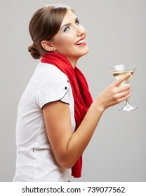 Smiling woman wearing red scarf holding alcohol cocktail drink glass. Isolated portrait.