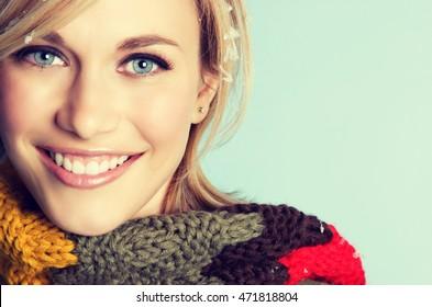 Smiling woman wearing winter scarf