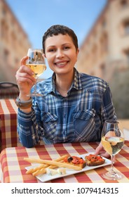 Smiling woman with wine glass