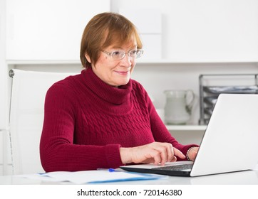 Smiling woman worker working effectively on project in office