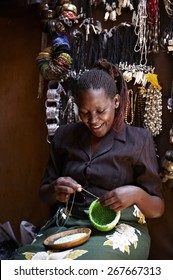 Smiling woman working in a street market in Nairobi (Kenya)