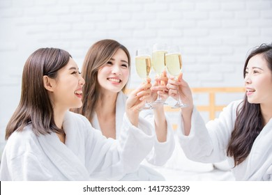 Smiling women friend with champagne in the spa salon or hotel
