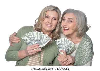 smiling women with money bills