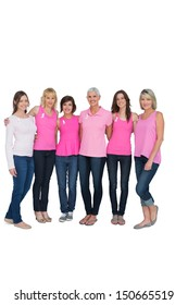 Smiling women posing with pink tops for breast cancer awareness on white background