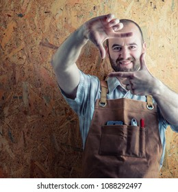 smiling wood worker with apron