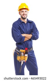 Smiling worker with arms crossed on white background