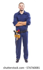 Smiling worker with arms crossed over white background