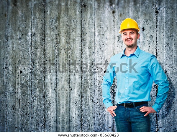 smiling worker and concrete texture background