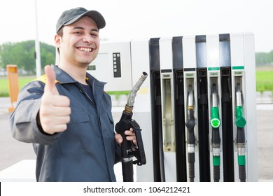 Smiling worker at the gas station giving thumbs up