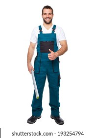 Smiling worker in uniform with spirit level isolated on white background