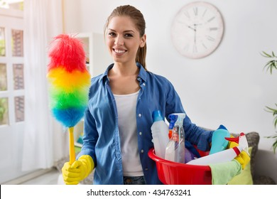 Smiling worth girl with the equipment for cleaning