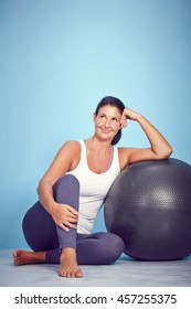 Smiling Yoga Woman With Excercise Ball