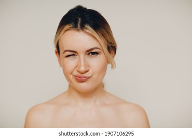Smiling young adult caucasian woman close up full face portrait with facial expressions