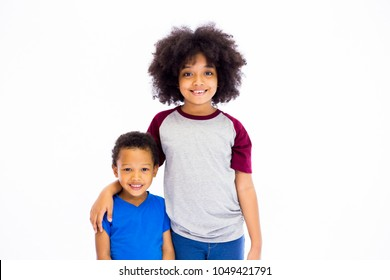 Smiling young African American sister and brother isolated over white background