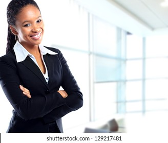 Smiling young african businesswoman with briefcase