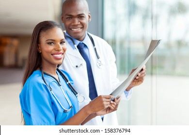 smiling young african medical doctors holding patient's x-ray