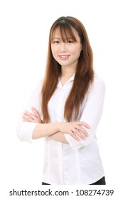 Smiling young asian business woman with arms crossed