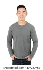 Smiling young Asian man in gray long sleeve t-shirt, on white background