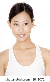 A smiling young asian woman in fitness wear on white background