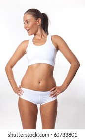 Smiling young athletic fitness woman