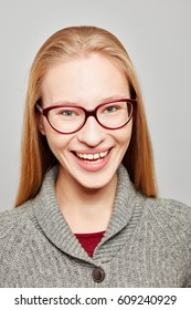 Smiling young and atractive blond woman wearing glasses