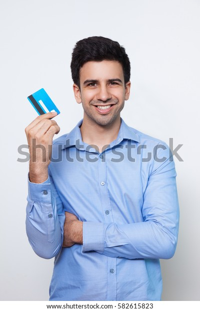Smiling Young Attractive Man Holding Credit Card