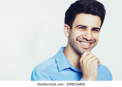 Smiling Young Attractive Man Touching Chin