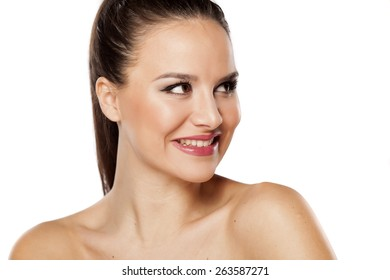 Smiling  young beautiful woman looking aside